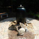 fountain near brick path