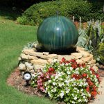 green fountain on stones