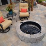 firepit with stone wall and furniture