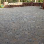 brick patio with brick wall