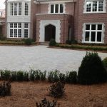 brick driveway and shrubs