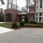 brick driveway and shrubs