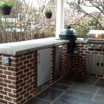 outdoor grill with red brick wall