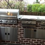 outdoor grill with red brick