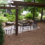 patio furniture under pergola