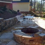 firepit and table and chairs in backyard