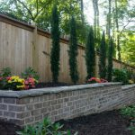 flower bed and brick wall
