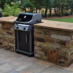 outdoor grill with stone wall