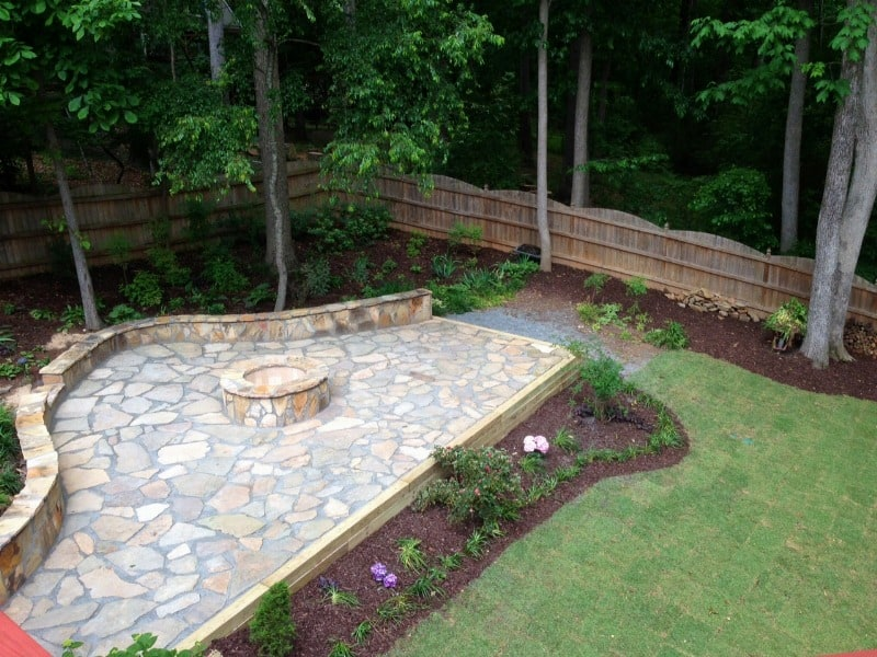 firepit and stone wall in backyard