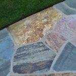 stone floor near green grass