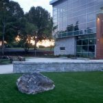 school building with grass and rock