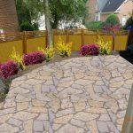 stone patio with shrubs