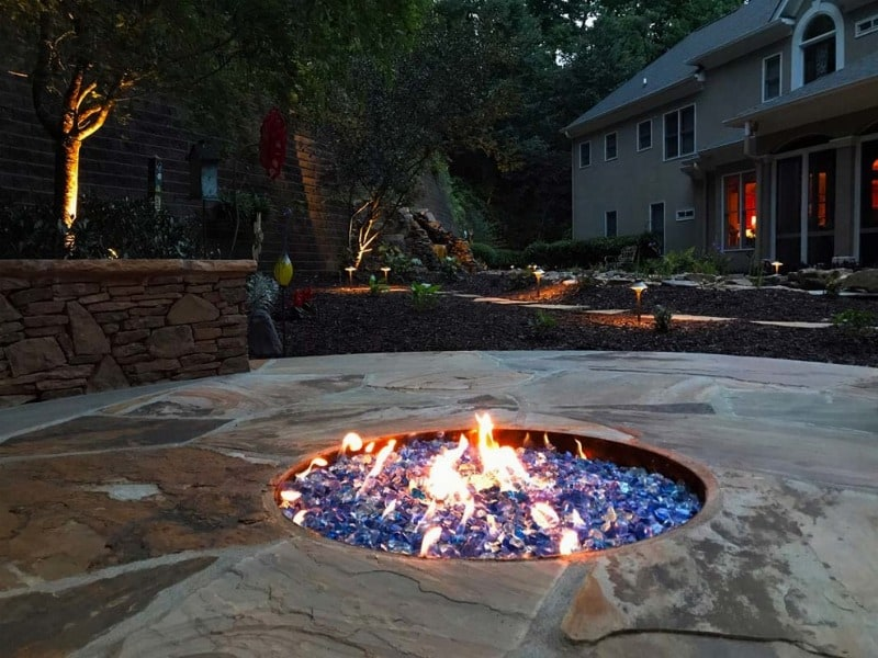 blue firepit on outdoor patio
