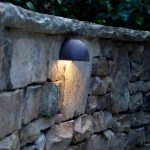 outdoor lighting on stone wall