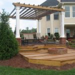 firepit and pergola in backyard